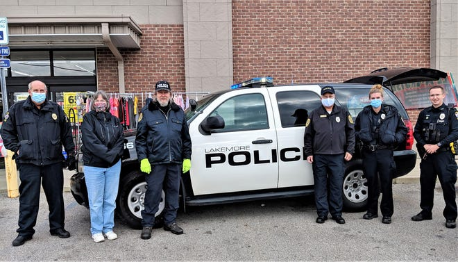 From left, Lakemore Police Chief Ken Ray, Darlene Haren of Springfield Cares, volunteer officer Bill Luplow, volunteer officer Emery Pitman, Lakemore officer Amanda Matthus and Lakemore officer Dylan Soisson outside the Dollar General as they collect donations for the community.