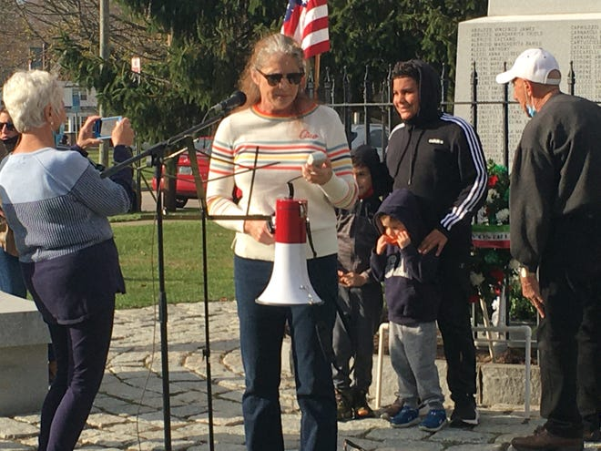 Lori Hopkins-Cavanaugh protesting changes made to the Norwich Italian American Heritage Monument in November. Hopkins-Cavanaugh will be a part of a protest against COVID-19 restrictions Saturday.