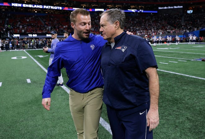 Los Angeles head coach Sean McVay, left, shown speaking with New England head coach Bill Belichick before Super Bowl 53 is still blaming himself for the loss to the Patriots.