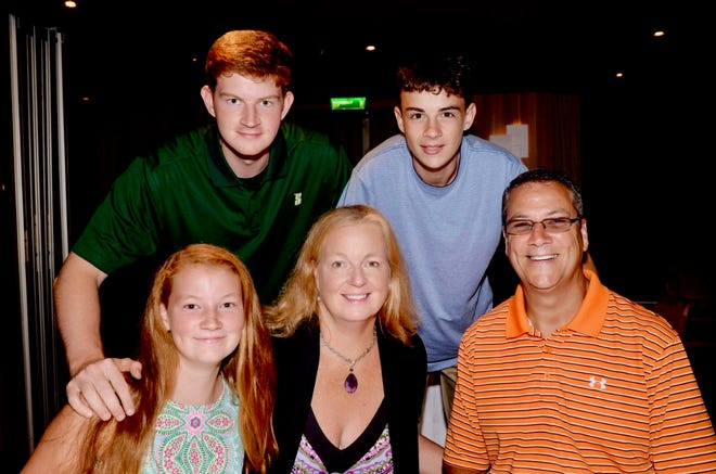 Doreen (Ferguson) Seymour, bottom middle, surrounded by her family (clockwise from top left), sons Sloan and Sean, husband Steve, and daughter Maggie.