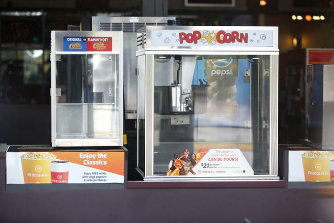 An empty popcorn machine is seen at the closed Regal Stadium 16 Cinema in Gainesville in October.