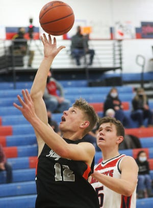 Ridgewood's Kole Hamilton drives to the basket as Indian Valley's Sam Caley defends in the game Tuesday.