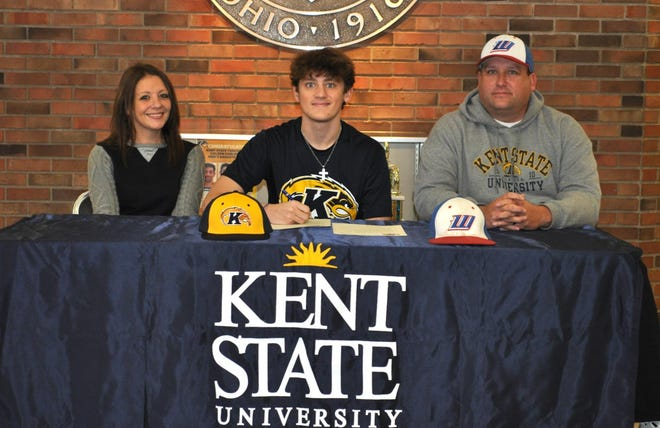 Signing a Letter of Intent is Tyler Randles (seated) shown with his mother Jennifer Oliver (left) and father Jeremy.