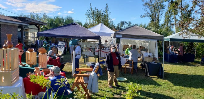 The annual Backyard Craft Festival hosted by Wes Swenson in Lynn Haven, raised a record amount for the city's animal shelter.