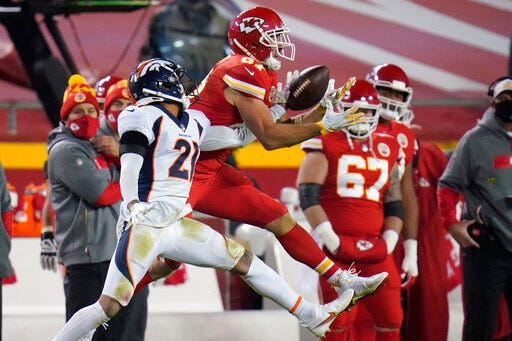 Denver Broncos cornerback A.J. Bouye, left, breaks up a pass intended for Kansas City Chiefs tight end Travis Kelce (87) in the second half on Sunday in Kansas City, Mo. (AP Photo/Jeff Roberson)