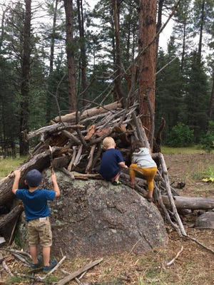 Nature and Wildlife Discovery Center's Earthkeeper Nature School students work together to build a fort in Pueblo Mountain Park