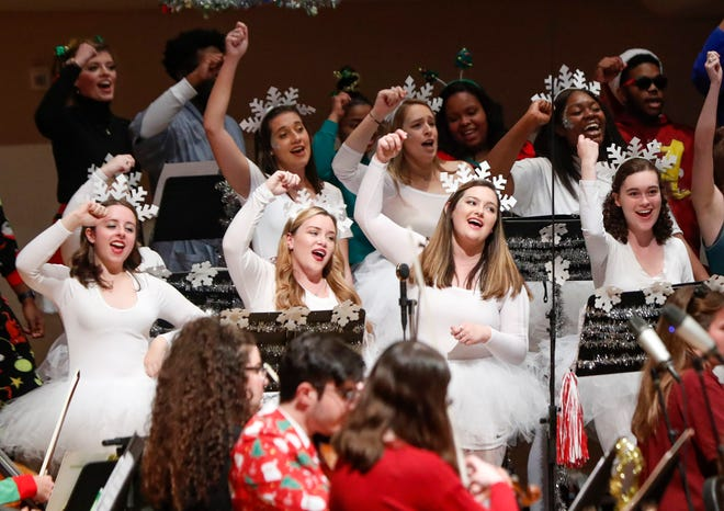 Singer and musicians perform at the Hilaritas holiday themed jazz show at Moody Music in Tuscaloosa, Ala. on Friday, Dec. 7, 2018. [Photo/Jake Arthur]