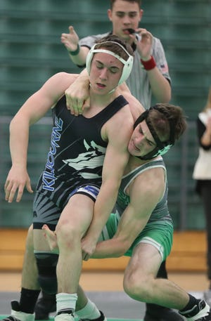 Junior Matthew Howard (right) is one of the top returnees for the Scioto wrestling team, which lost three Division I state qualifiers to graduation.