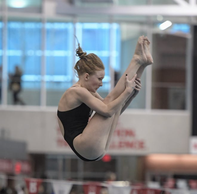 "Junior diver Emma Skinner is one of several New Albany returnees who competed in the Division I state meet last season. The Eagles boys and girls teams expect similar success this winter, and coach Dave Wharton said ""expectations are high."""