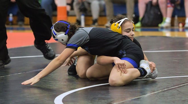 Reynoldsburg's Gracie Straughter tangles with Casstown Miami East's Lily Bruggeman during the inaugural girls state tournament last February. The junior is ranked fourth in the state preseason rankings at 111 pounds, according to Raiders coach Jon Forgy.