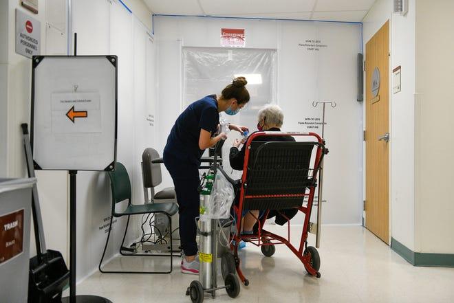 A Providence St. Mary Medical Center nurse treats a patient near temporary walls inside the hospital on Tuesday, Dec. 8 2020.