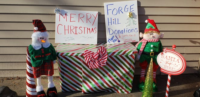 Jen Conley of Franklin and Cheryl Melendy of Bellingham are behind a drive to collect holiday gifts for residents at Benchmark Senior LIving at Forge Hill in Franklin. They are accepting donations through Dec. 17. This is the donation box Conley has put out at her home.