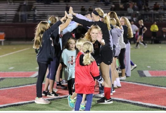 Marblehead girls' soccer midfielder Ella Kramer is shown emerging from the tunnel to high-five MYSA players in 2019, and after an all-star season last year Kramer is back to be one of the team's three 2021 captains.