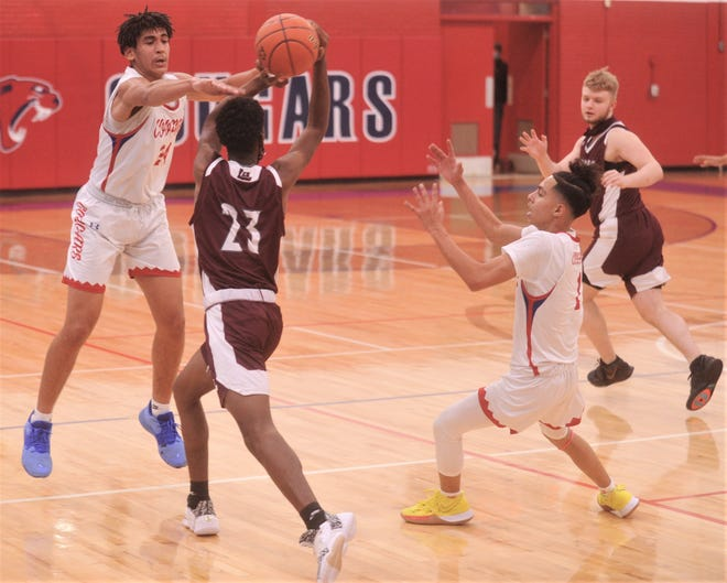 Cooper's Jalen Cherry (24), left, defends against Midland Lee's Timothy Whitfield during Tuesday's game. Cherry was coming off a big week, scoring 18 points against 4A No. 12 Lubbock Estacado and 22 against Wichita Falls Rider, both game highs, to earn Abilene Reporter-News Local Player of the Week for the week ending Dec. 5.