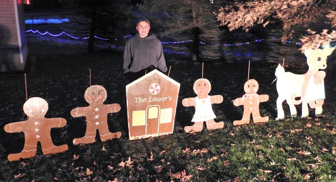 Brady Lower, 13, is the primary decorator of his family's property on County Road 93 in Fresno. The gingerbread people and house were made by his aunt and the reindeer by his late grandmother.