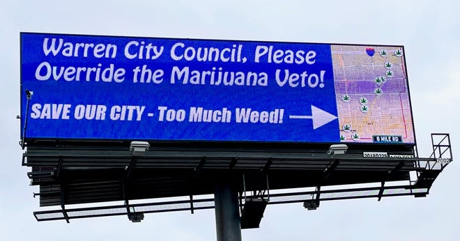 This billboard, erected on Monday, Dec. 7, 2020 on Groesbeck Hwy. just north of I-696, was placed by Roseville residents to urge the Warren City Council to override a mayoral veto of a legal settlement with marijuana investors -- a move that the City Council decided was unnecessary. (Photo: Defend Warren)