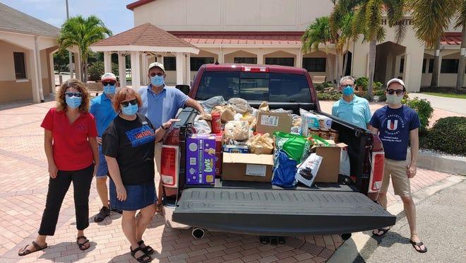 Every Thursday, members of Faith Presbyterian Church drive to the church to donate food.
