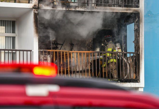 Guam Fire Department personnel respond to a fire that erupted within Unit 210, one the second floor of the Tumon View Phase 1 condominiums on Wednesday, Dec. 9, 2020. An occupant at the apartment, who was home at the time, reported a loud explosion on his balcony before the blaze, said Vangie Cepeda, Century 21 Realty Management property manager for the complex.