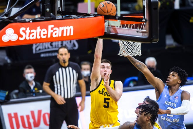CJ Fredrick, left, scored 21 points in this nonconference win vs. North Carolina on Dec. 8 for the Hawkeyes.