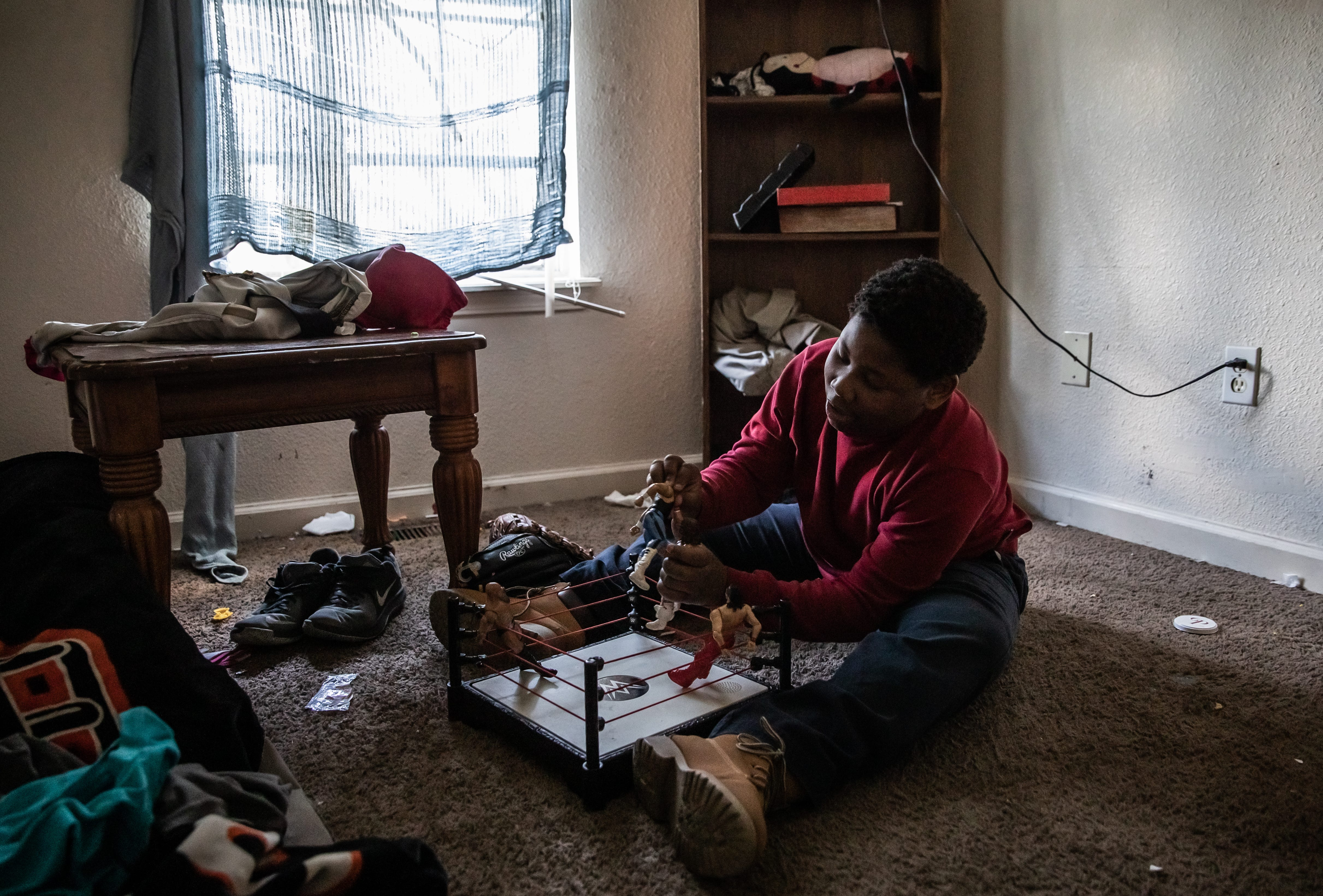 """Antonio O'Neil, 10, an Indy Steelers football player known to his teammates as Mouthpiece, plays with WWE figurines in his room Monday, April 15, 2019. """"I had John Cena but somebody stoled him,"""" he said. """"I'll just have to gets another one."""" O'Neil got his nickname because he always loses his mouthpiece. """"I have bought Antonio, I don't know, 12 or 13 mouthpieces and he never knows where they're at,"""" said Robert O'Neil, Antonio's father. """"He probably doesn't know where it is right now."""""""