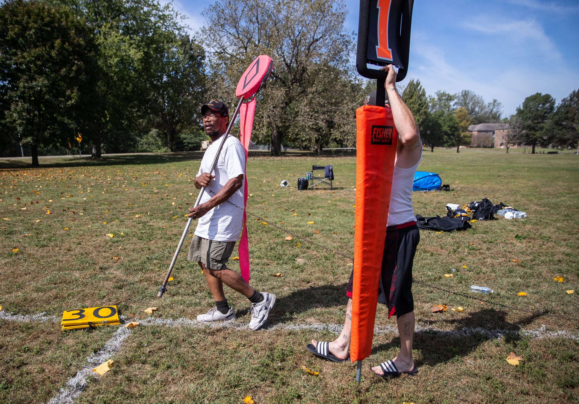 Robert O'Neil, father of Indy Steelers player Antonio, volunteers to be on the football chain crew during his son's game at Watkins Park on Sunday, Sept. 22, 2019. O'Neil would spend all day at the park, then head into work at his third-shift custodial job.