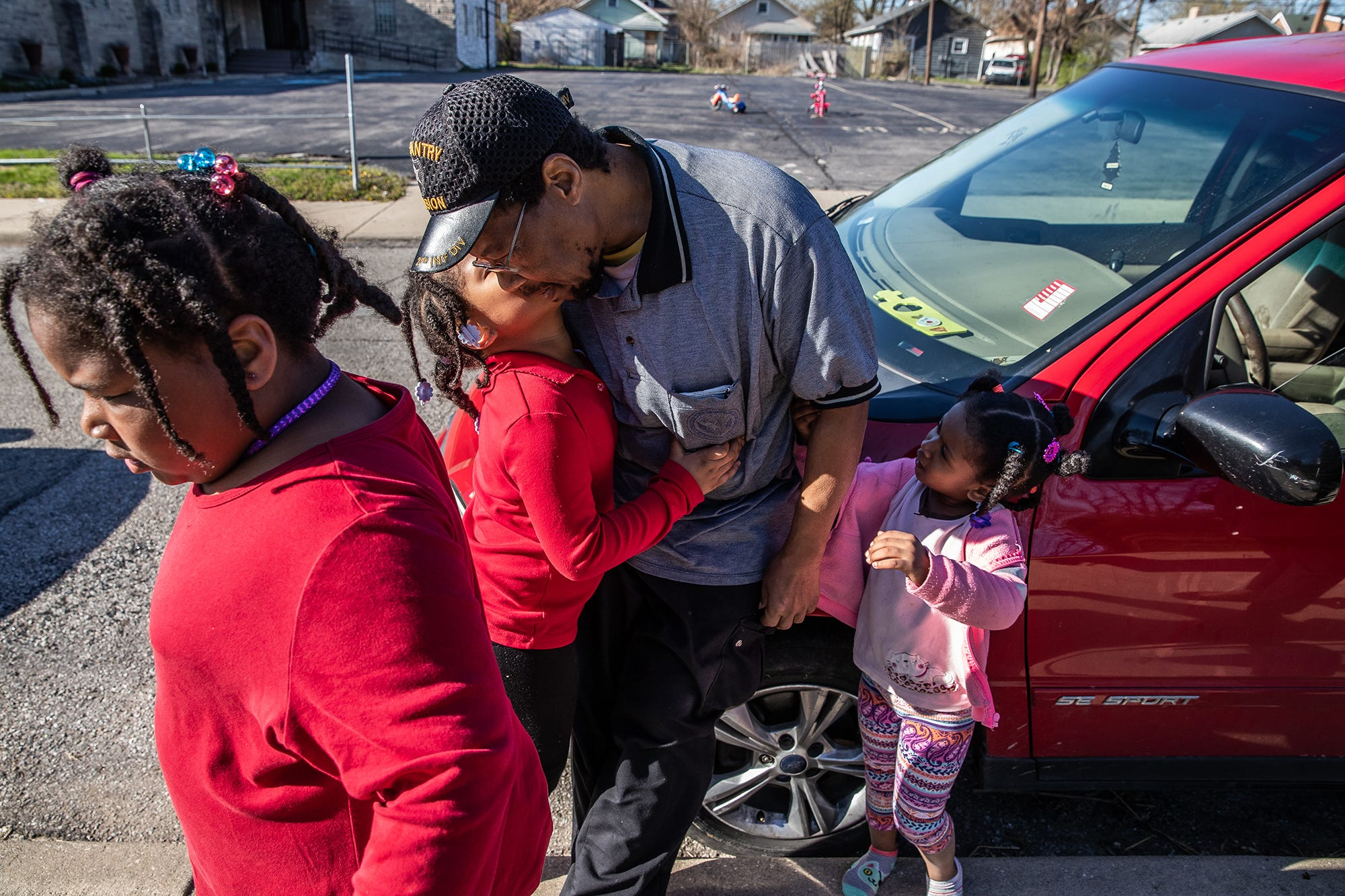 """Robert O'Neil gets a hug from each of his girls, Mary, 8, Adriane, 6, and Angel, 3, on Monday, April 15, 2019. O'Neil is a single father of four, three girls and one boy, Antonio, 11. """"I'm an old guy, I'm not a spring chicken no more, you know what I mean?"""" said Robert. """"Having them kind of makes me feel young, they keep me going."""" The mother of the four children suffers from chemical and substance abuse, which is why, according to O'Neil, he is raising the children alone."""