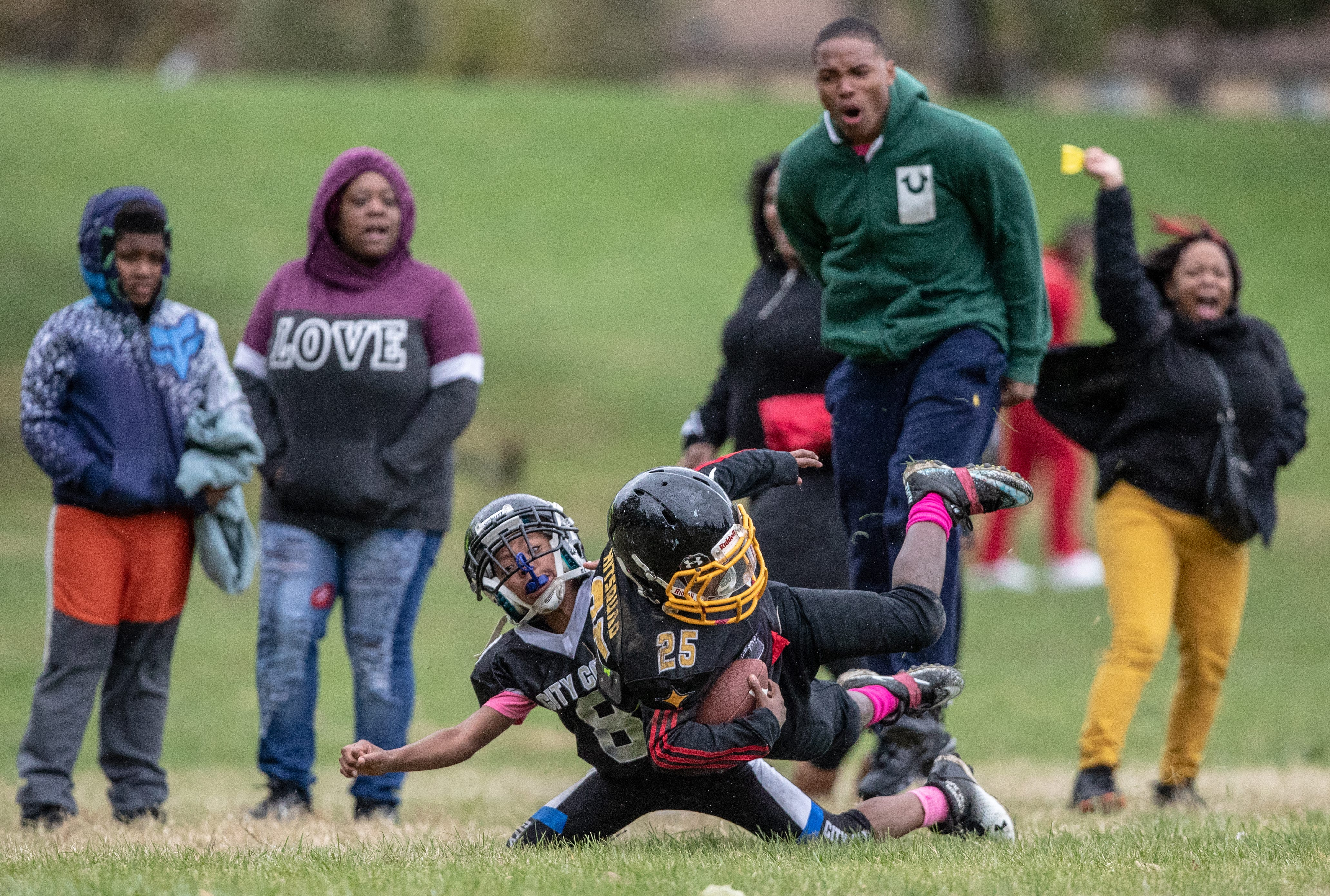 """Indy Steelers fans and family react after a long run during a game on the city's east side. """"This is the group that everyone counted out. This is the group of kids that people thought wasn't going to make it,"""" said Takkara Delaney, a single mother of five with three boys on the Steelers team. """"The heart and soul of that team is caring about those kids. It's not just the sport. The sport is the reason we probably get together but the reason we stay together is because there's a love and a bond there that can't be broken."""""""