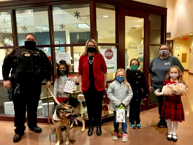 From left, Dog Warden Scott Mills, Alina Babb, Top Dog Titan, Clerk of Courts Jessica Wallace, Fourth place winner Isabella Webb, Third place winner Kayla Lawrence, second place winner Breahleynn Sparling and dog, Gemma, and Deputy Auditor Amber Davis.