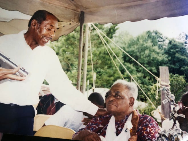 James David Causey, left, photographed with his stepfather, Orelious Pinkney, right, in this 1994 photo.