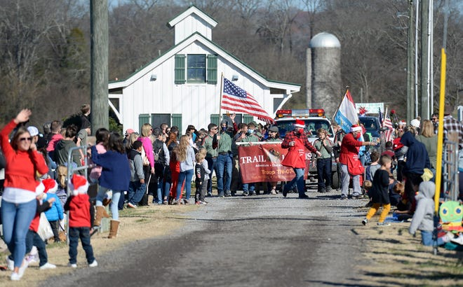 People wait for the start of the Franklin Christmas parade at The Park at Harlinsdale Farm Saturday, Dec. 5, 2020, in Franklin, Tenn. Despite COVID-19 guidelines, few people wore masks or social distanced at the event held in lieu of the traditional Kiwanis parade.