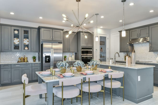 Hamilton Place recently introduced its new Hibiscus townhome design, which offers the most expansive floor plan in the community and includes a well-appointed kitchen with a large center island.