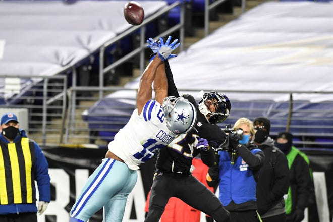 Dallas Cowboys wide receiver Amari Cooper (19) has pass broken up by Baltimore Ravens cornerback Anthony Averett (23) during the second half of an NFL football game, Tuesday, Dec. 8, 2020, in Baltimore. (AP Photo/Terrance Williams)