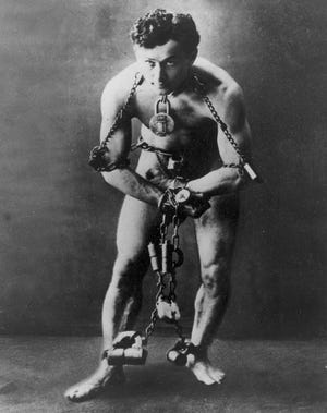 Legendary escape artist Harry Houdini is shown in chains in this 1899 photo.