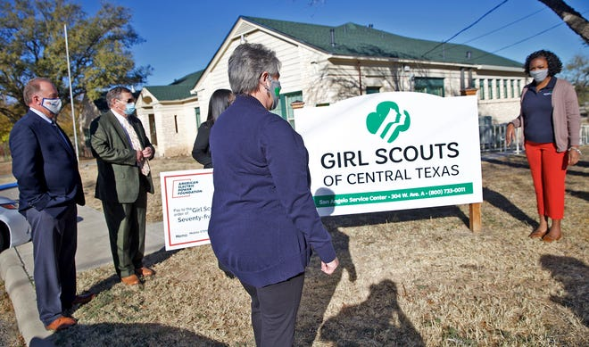 Representatives from the Girl Scouts of Central Texas and American Electric Power Texas look for a spot for a photo opportunity for the presentation of a check Tuesday, Dec. 8, 2020.