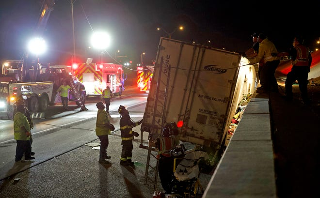 First responders work to rescue the victim of a crash on Houston Harte near the Howard St. overpass Tuesday, Dec. 8, 2020. The vehicle was pinned between the tractor trailer and a retaining wall.