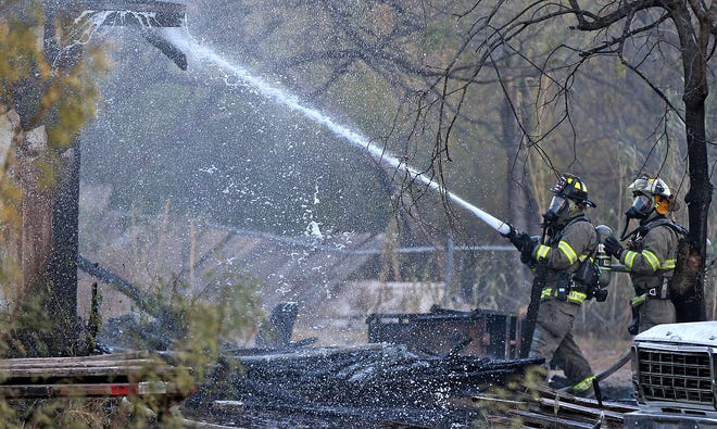 Firefighters with the San Angelo Fire Department work to put out a fire at a residence near E. Avenue L and Duggan St. on Tuesday, Dec. 8, 2020.