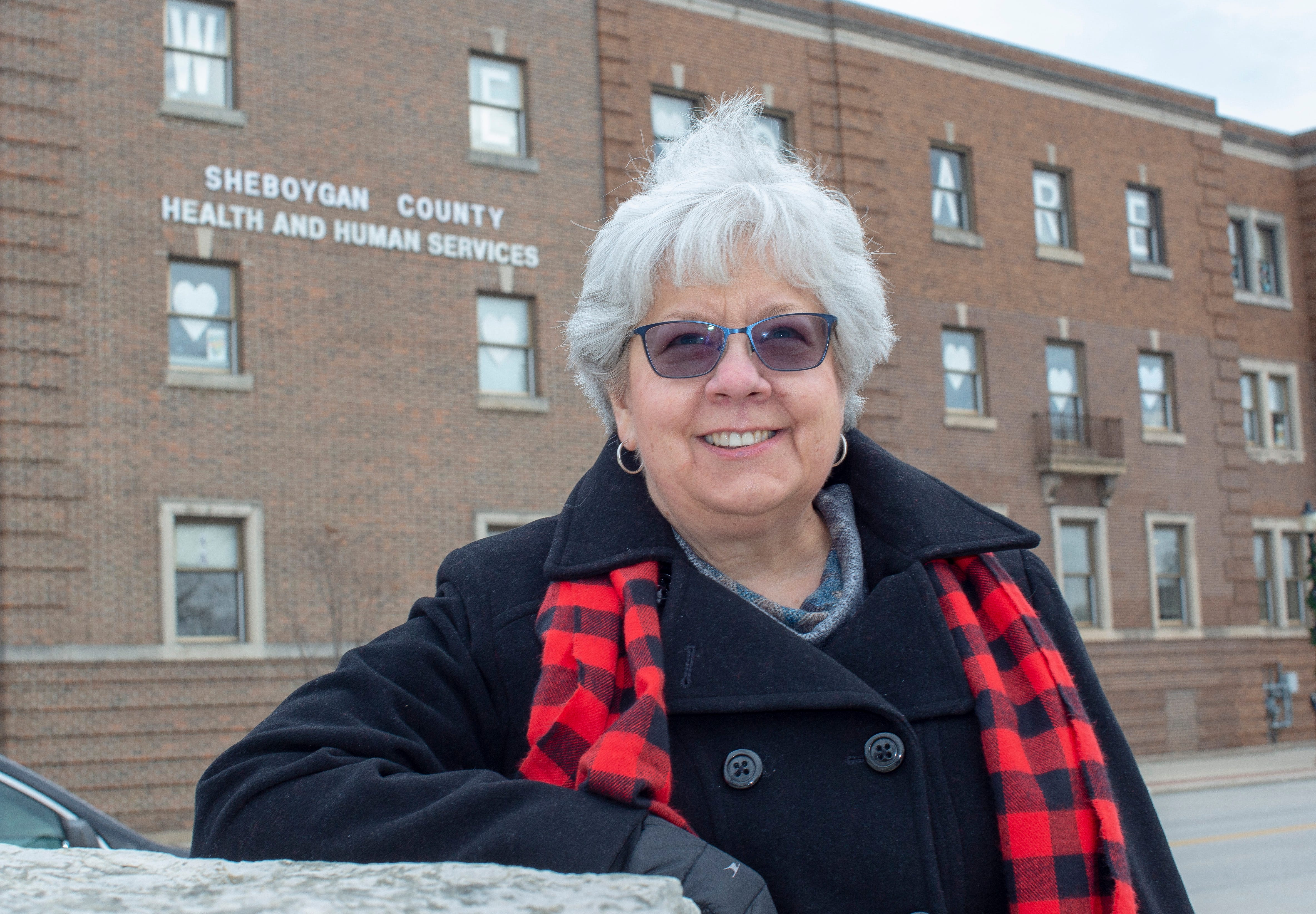 Jean Beinemann, who came out of retirement to help with the pandemic response for six months, poses near the Sheboygan County Health and Human Services Building on Tuesday, Dec. 8.