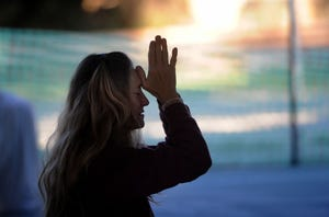 Lee Ann McGuire, an instructor of Ventura's Grassroots Yoga, teaches a meditation class Wednesday, Dec. 9, 2020, at the basketball courts at Camino Real Park in Ventura.
