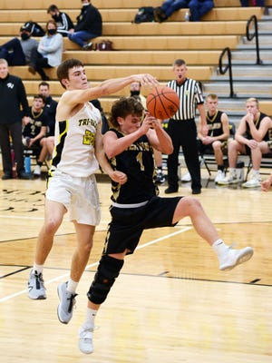 Tri-Valley's Aaron Frueh, left, and River View's Cal Shrimplin fight for a rebound on Tuesday night in Dresden. Tri-Valley won, 66-47.