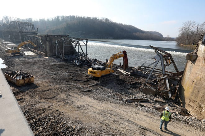 Two spans of the Phio-Duncan Falls Bridge were dropped onto a causeway on Wednesday, and scrapping began. By Wednesday afternoon, one span had nearly disappeared. A bridge connecting the Duncan Falls and Philo communities opened earlier this year. It is named in honor of Lt. Michael J. Lutz of the Muskingum County Sheriff's Department, who was killed in the line of duty in 1994.