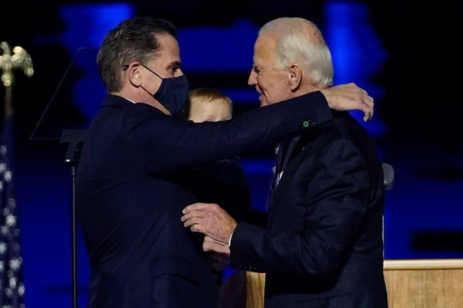 In this Nov. 7, 2020, file photo, President-elect Joe Biden, right, embraces his son Hunter Biden, left, in Wilmington, Delaware.