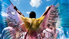 A protester displays wings while marching on on June 14, 2020 in the Brooklyn borough of New York City.