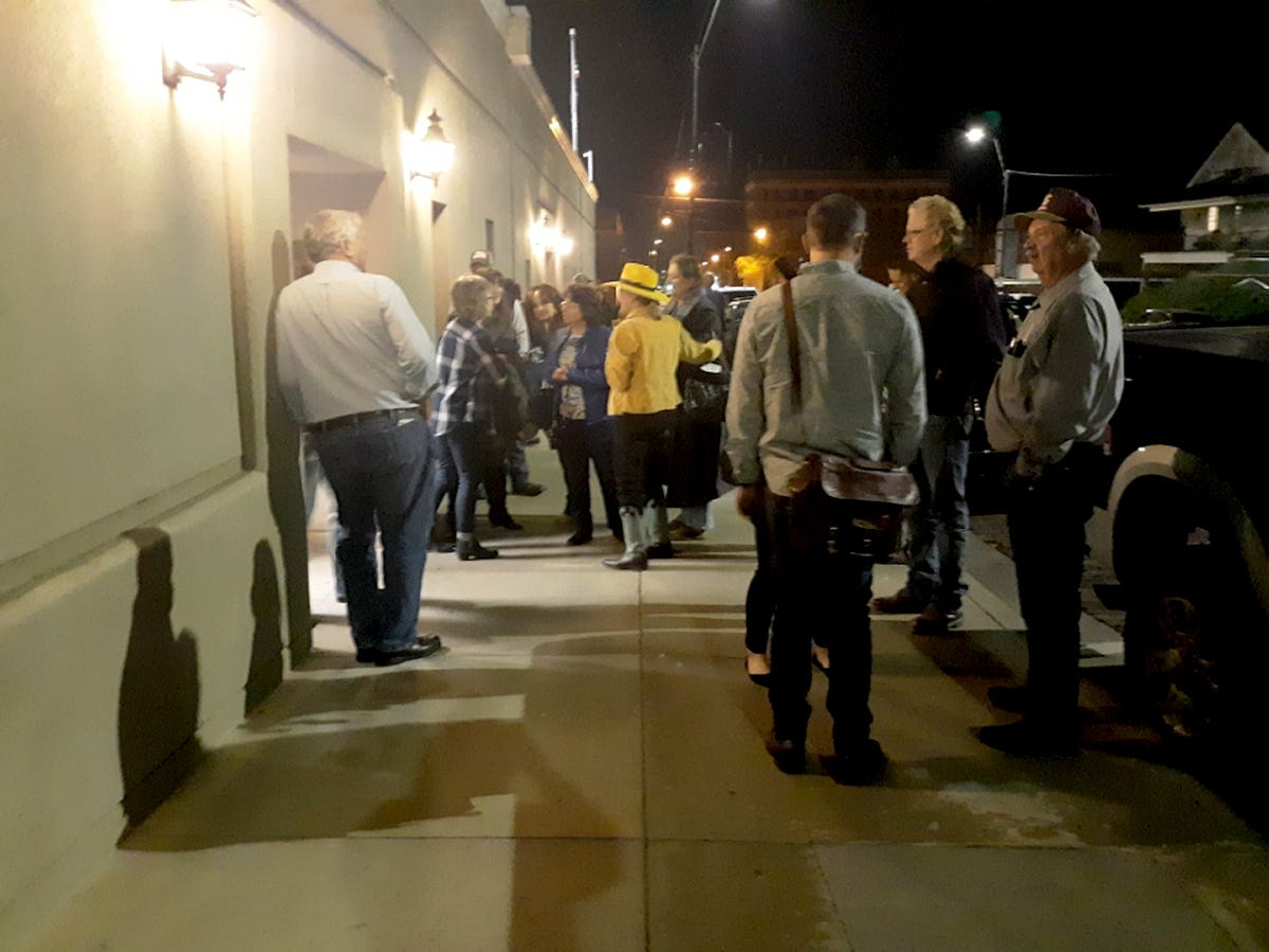 Residents of Dodge City, Kan., wait outside City Hall to speak before the city commission regarding the city's mask mandate on Nov. 16, 2020.