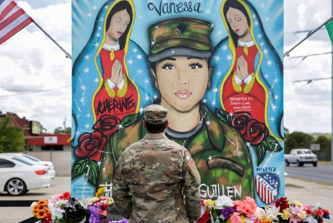 First Lt. Spencer Daulisa pays his respects at a memorial for Spc. Vanessa Guillen outside of Fort Hood in Killeen. Guillen's disappearance and death led to calls for more accountability from military leaders over sexual misconduct at the Army installation.