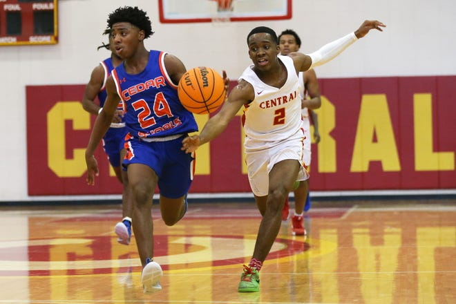 Clarke Central's Jaiquez Smith (2) attempts to steal the ball from Cedar Shoals Kashik Brown (24) during a GHSA basketball game between Clarke Central and Cedar Shoals in Athens, Ga., on Saturday, Jan. 25, 2020. Cedar Shoals defeated Clarke Central 66-56.[Photo/Austin Steele for Athens Banner-Herald]
