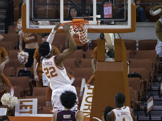 Texas forward Kai Jones dunks during the first half of Wednesday night's 74-53 win over Texas State at the Erwin Center.