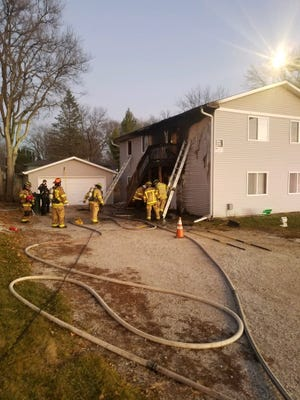 Ames firefighters respond to a structure fire at 218 S. Dakota Ave. on Dec. 9.