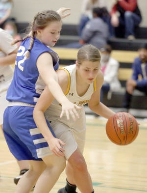 LSE's Josie Ray applies pressure in the second half Wednesday night against Smith-Cotton in the LSE/Ss. Peter & Paul Invitational Tournament.