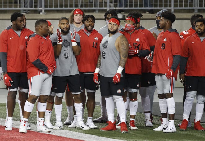 Ohio State defensive players get ready for warm-ups before the game against Rutgers on Nov. 7. Instead of playing Michigan on Saturday, the Buckeyes will have a light practice and watch Northwestern's regular-season finale against Illinois.