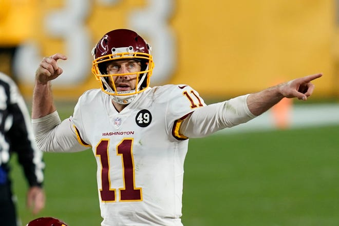 Washington Football Team quarterback Alex Smith (11) calls a play during Monday's game against the Pittsburgh Steelers in Pittsburgh.